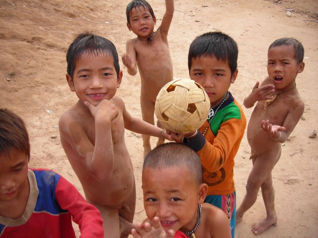 kids playing soccer with bamboball