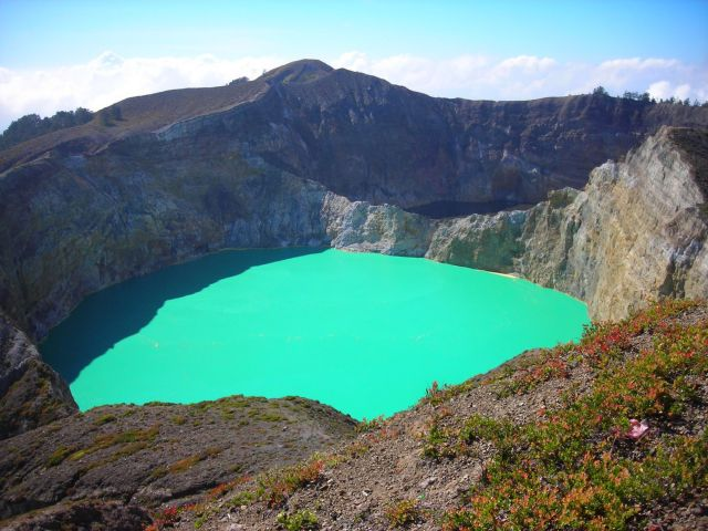 the famous crater lake of Kelimutu on the island of Flores in Eastern Indonesia